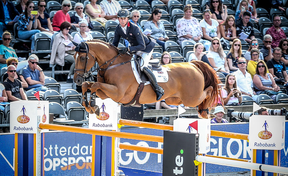 British Ben Maher took the individual lead after the second competition of the Longines FEI European Jumping Championships aboard Explosion W (photo: Claire Simler)